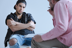 Rebellious, withdrawn Boy in counseling session