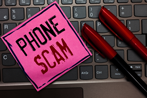 post it note with Phone Scam writing